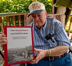 Local historian and author John M. Ham poses with his latest book. The quality of the B&W photos in this one is amazing.