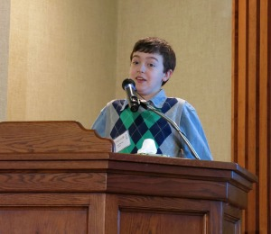 Isaac Barnes shows another side of Dr. Novak by reciting some of her poetry.