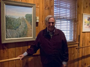 Peter Liman with one of his paintings